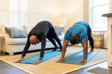 Black Gay Couple Doing Yoga Exercises At Home Together, Healthy Lifestyle