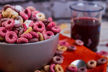 Bad Breakfast Of Colorful Cereals Full Of Sugar With Red Fruit Juice