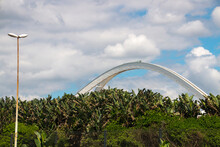 Architectural Arch Of  Moses Mabhida Stadium Above Green Vegetation