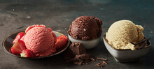 Assorted Yummy Ice Cream Scoops On Table