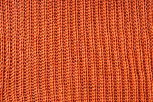 Close Up Photo Of Orange Wool Cloth Texture.