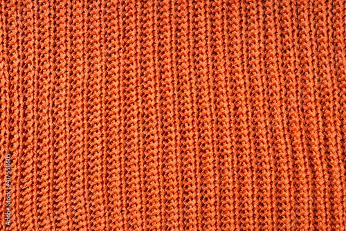 Fotografie, Obraz Close up photo of orange wool cloth texture.