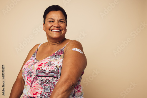 Senior woman smiling after getting vaccination Fototapet