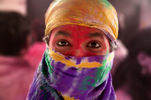 PORTRAIT OF A WOMAN COVERED IN MULTICOLOUR DUPATTA AND LOOKING AT CAMERA