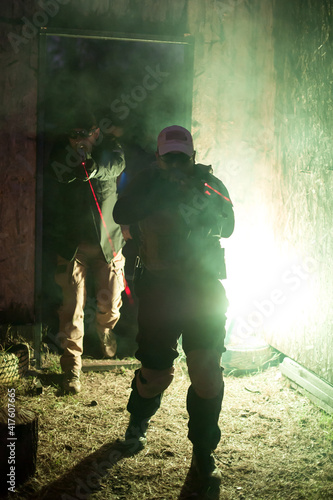 Fotografija Army soldier in action aiming at weapon laser sight optics