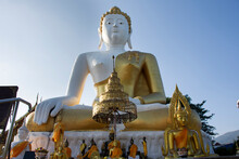 Big Golden Buddha Image Statue Of Wat Phra That Doi Kham Or Temple Of The Golden Mountain For Thai People And Foreign Travelers Travel Visit And Respect Praying At Mae Hia In Chiang Mai, Thailand