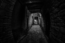 A BLACK AND WHITE PHOTO FROM A TUNNEL