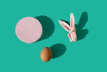 Pink Paper Napkin Origami Easter Bunny With Round Shape And Egg On A Pastel Mint Background