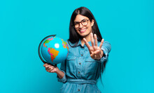Young Hispanic Woman Smiling And Looking Friendly, Showing Number Four Or Fourth With Hand Forward, Counting Down. Earth Planet Concept