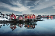 Traditional Red Wooden House At Waterfront In Fishing Village On Winter At Reine Town, Lofoten Islands