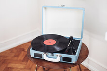 Retro Blue Record Player On A Wooden Background