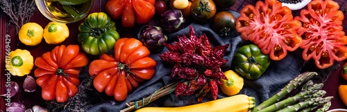 Fototapeta Composition with raw vegetables asparagus and ox heart tomatoes obraz