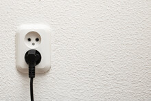 Twp Sockets On White Wall Close Up