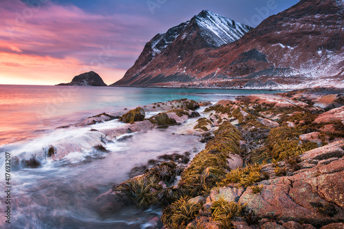 Fotografie, Obraz Sunset Norway landscape of picturesque stones on the arctic beach of cold Norweg
