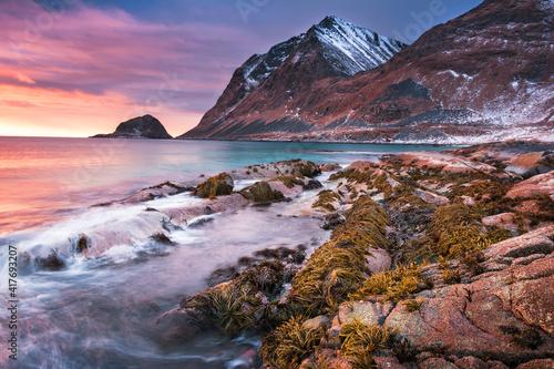 Fototapeta Sunset Norway landscape of picturesque stones on the arctic beach of cold Norweg