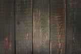Brown wooden background, textured cutting board.