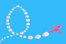 Pink Airplane Goes Into A Sharp Turn On Blue Background And Easter Egg Of Abstract Shapes Of Cloud. Festive Minimal Composition. Happy Easter Holiday Concept, Copy Space