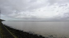 Overcast British River Mersey Waterfront Fast Clouds Timelapse Over Rippling Coastal Water