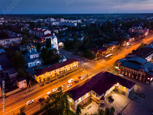 Fotografija Scenic view from drone of Cathedral of Intercession of Holy Virgin with belfry and Russian Route M7 (Volga Highway) on background with Pokrov cityscape at twilight