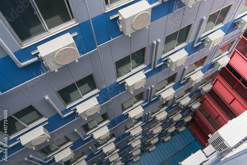 Air conditioning compressor system assembled on window of building © weerayut