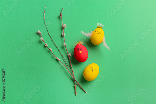 Fotografie, Obraz Creative Easter eggs with pussy willow on color background