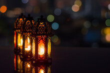 Lanterns With Night Sky And City Bokeh Light Background For The Muslim Feast Of The Holy Month Of Ramadan Kareem.