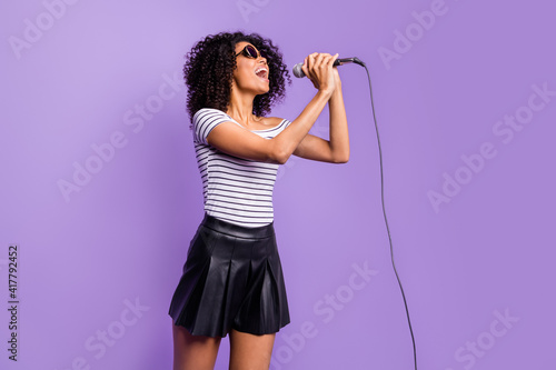 Photo Portrait of pretty carefree dark skin lady arms hold mic open mouth singing loud