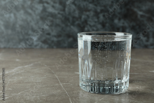 Glass of mineral water on gray table © Atlas