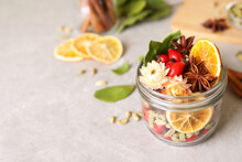 Aromatic Potpourri In Glass Jar On Light Table. Space For Text