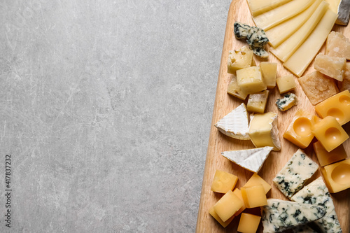 Fototapeta Cheese plate on grey table, top view. Space for text
