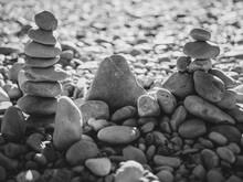 Black White Stone Pyramid On The Background Of Stone Desert Symbolizing Stability, Zen, Harmony And Balance