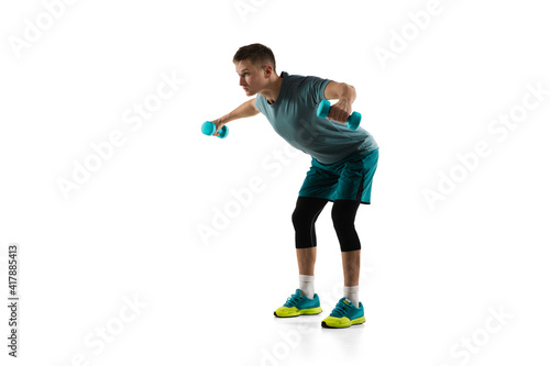 Fototapeta Strong. Young caucasian male model in action, motion isolated on white background with copyspace. Concept of sport, movement, energy and dynamic, healthy lifestyle. Training, practicing. Authentic. obraz
