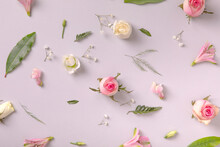 Spring Flowers Background. Roses, Pink Flora And Leaves Random Set On Gray Background. Flat Lay Concept, Pastel Aestetic