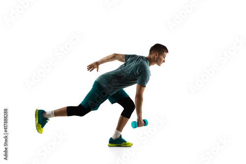 Fototapeta Healthy. Young caucasian male model in action, motion isolated on white background with copyspace. Concept of sport, movement, energy and dynamic, healthy lifestyle. Training, practicing. Authentic. obraz