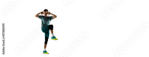 Fototapeta Flyer. Young caucasian male model in action, motion isolated on white background with copyspace. Concept of sport, movement, energy and dynamic, healthy lifestyle. Training, practicing. Authentic. obraz