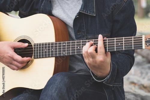 Fototapeta musician playing strum acoustic guitar.