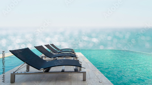 Carta da parati Luxury poolside with sun beds and deck chairs over blue sea
