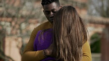 Interracial Couple Empathic Embrace. Young Woman Romantic Connection With Partner Outside