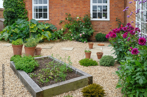 Canvas Landscaped courtyard garden with raised beds, UK