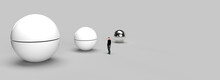 A Lonely Man In The Middle Of A Big Room With Three Giant Spheres. 3d Render