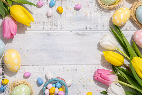 Obraz Happy easter background with bunnies, eggs, candies flowers - fototapety do salonu