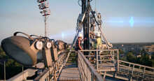 Male Technicians Fixing Transmitting Antenna