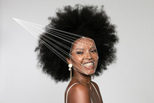 Smiling Afro Woman With Facial Recognition Laser Beam Against White Background