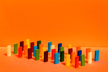 Arrangement Of Colorful Toy Blocks In A Row On Orange Background