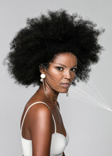 Afro Woman With Facial Recognition Laser Beams Against White Background