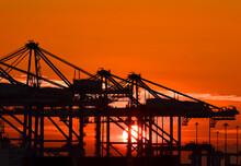 Silhouette Of Dockside Cranes At Sunrise, Birzebugga, Malta