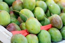 Closeup Shot Of A Pile Of Ripe Mangos At A Market