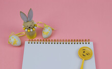 Easter Card With Bunny And Eggs.  Notepad With Bunny And Eggs On A Pink Background With A Place For Text, Close-up Side View.