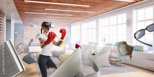 Fototapeta Young woman boxing in VR glasses obraz