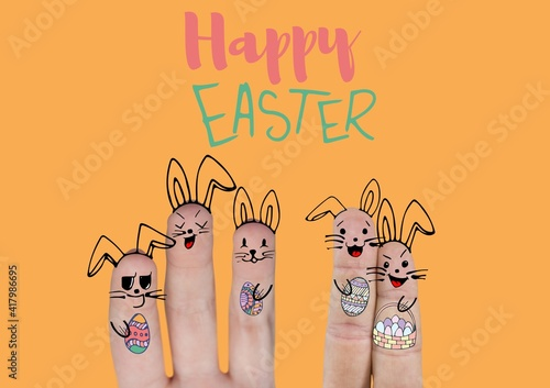 Happy easter text with fingers decorated with bunny ears and easter eggs on orange background